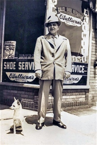 Michele Zullo standing before his shoe shop